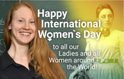 "Noémie Combe neben einem alten Porträt von Emmy Noether und den Worten ""Happy International Women's Day, to all our Ladies and all Women around the World!"""